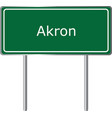 akron alabama usa road sign green vector image vector image