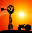windmill australian silhouette sunset with tractor