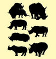 cute rhinos animal silhouette in different poses vector image vector image