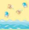 beach umbrellas striped towels and ball on sand vector image vector image