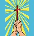 christian cross in light hands the vector image