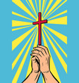 christian cross in light hands vector image