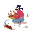 woman sitting on ground with bowl in hands vector image vector image