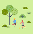 two boys playing soccer in the vector image vector image