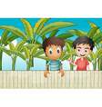 Two friends near the wooden fence vector image vector image