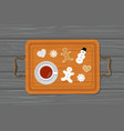 cup of tea and gingerbread on tray vector image