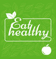 Label eat healthy on green background the sticker
