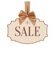 sale banner with golden ribbon and a bow vector image vector image