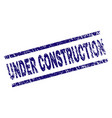 scratched textured under construction stamp seal vector image vector image