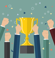 Business people holding up a winning trophy vector image