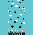 graduates hands throwing graduation hats in the vector image