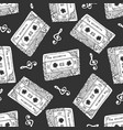 seamless pattern with vintage cassettes black and vector image vector image