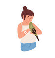 kid kissing parrot happy child holding budgerigar vector image vector image