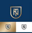 t and n monogram gold shield premium emblem vector image