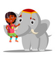 elephant holds a little indian girl on trunk vector image