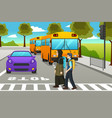 two students crossing the street to go to school vector image