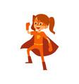 kid girl in orange superhero costume standing
