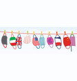 washed protective face masks hanging on a line vector image