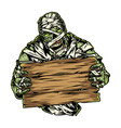 spooky mummy holding blank wooden board vector image