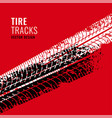 red background with tire tracks mark vector image vector image