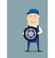 Happy car mechanic with wheel vector image vector image