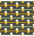Seamless pattern orange glass beer mug on a brown vector image