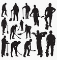 worker with spade silhouettes vector image vector image