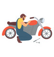 man repairing motorcycle isolated character vector image vector image