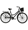 Black silhouette of a bicycle with a basket vector image