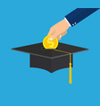 hand put gold coin in graduation cap vector image