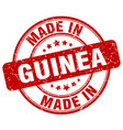 made in guinea red grunge round stamp vector image vector image