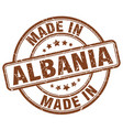 made in albania brown grunge round stamp vector image vector image
