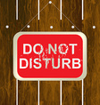DO NOT DISTURB sign hanging on a wooden fence vector image vector image