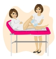 Young beautician waxing young woman legs vector image
