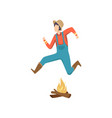 cowboy jumping over fire at folklore party festa vector image
