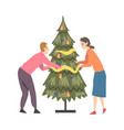 couple decorating christmas tree young man vector image vector image