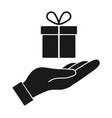 gift in hand icon vector image vector image