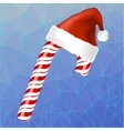 Sweet Red Candy Cane and Hat of Santa Claus vector image vector image