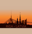 riga old town skyline during sunset time vector image vector image