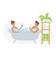 cute couple taking bubble bath holding glasses