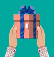 gift box in hand vector image vector image