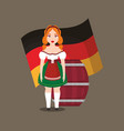 german woman with beer barrel and flag vector image