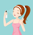 Girl Spraying Mineral Water On Her Face vector image vector image