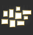 golden photo picture frames on black wall vector image vector image