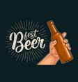 man hand holding open bottle beer fest