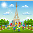 happy kids bring a balloons in front of eiffel tow vector image