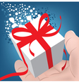 gift box in a mans hand vector image vector image