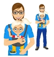 father holding little girl with baby carrier vector image vector image