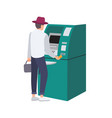 man standing beside atm and inserting credit card vector image vector image