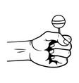 pop art hand with lollipop cartoon in black and vector image